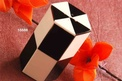 Resin salt or pepper dispenser in cream and black colour with a geometric design