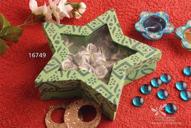 Green and blue star shaped gift box made of handmade paper and plastic