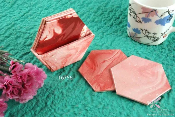 Set of six coasters of handmade paper in powdery pink colour