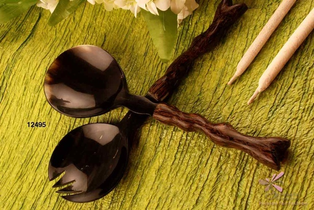Salad set with a spoon and fork of horn and wood in black and dark brown colour