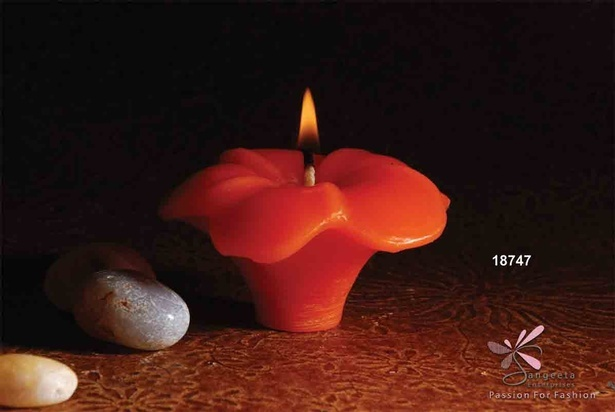Orange colour scented candle in the shape of a flower