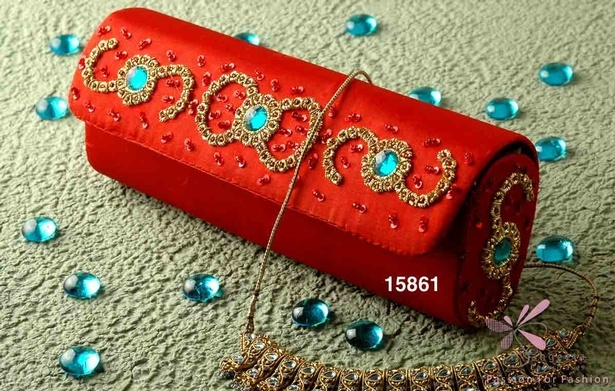 Ruby red glamorous ornamented purse by Sangeeta Enterprises