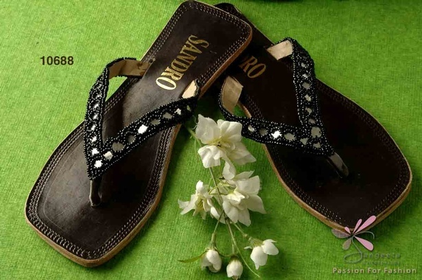 Black pair of beaded slippers in leatherette upper and rubber sole