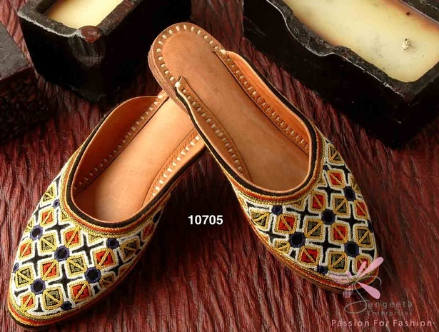 Multi-coloured Leatherette embroidered pair of juttis at Sangeeta Enterprises