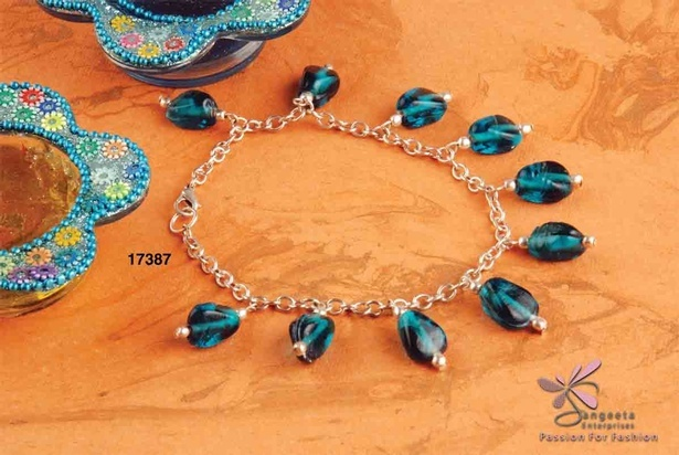 Dark turquoise blue and silver colour anklet in glass and metal