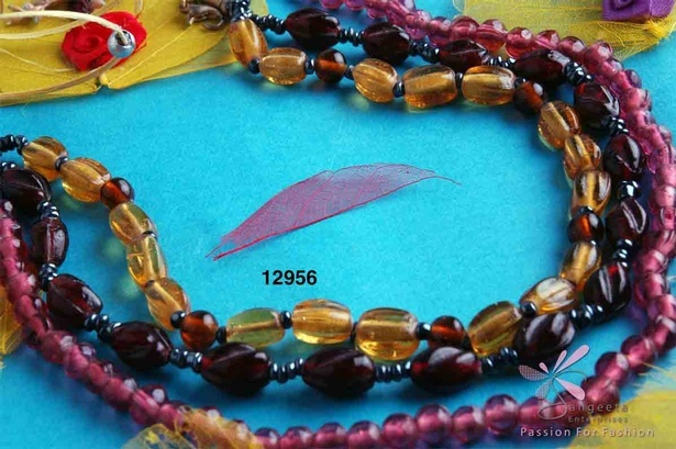 Triple-row glass choker in pink, yellow, maroon, brown and gunmetal colour