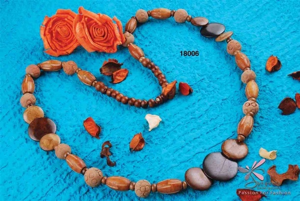 Mud beads, bone and wooden necklace in different shades of brown