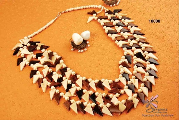 Necklace made of bone in off-white and dark brown colour
