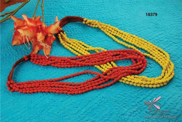 Red and yellow multi row necklaces at Sangeeta Enterprises