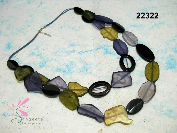 Resin necklace in blue, black, green and yellow colour