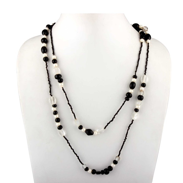 Glass and acrylic necklace in black, white and silver colour combination