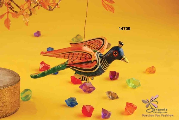 Colourful toy made of wood and metal in the shape of a peacock