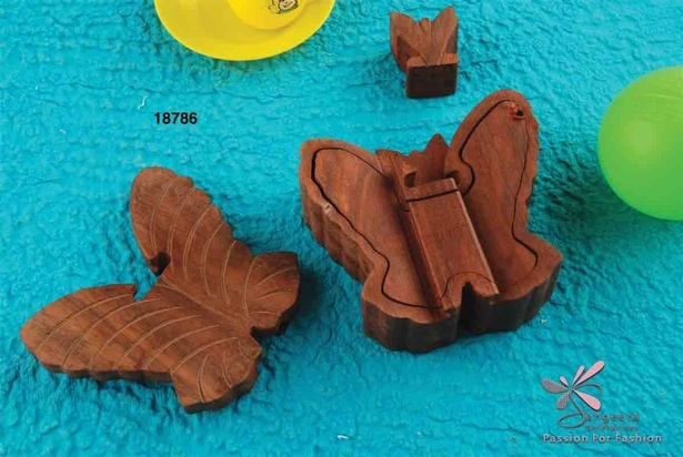 Dark brown puzzle in a butterfly shape made from wood
