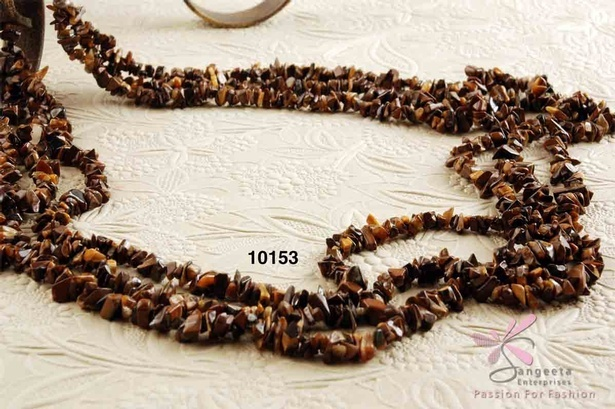 Triple-row necklace in uncut beads of Tiger's eye