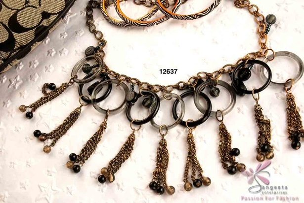 Fancy metal chain necklace in antique brass colour with black and white rings