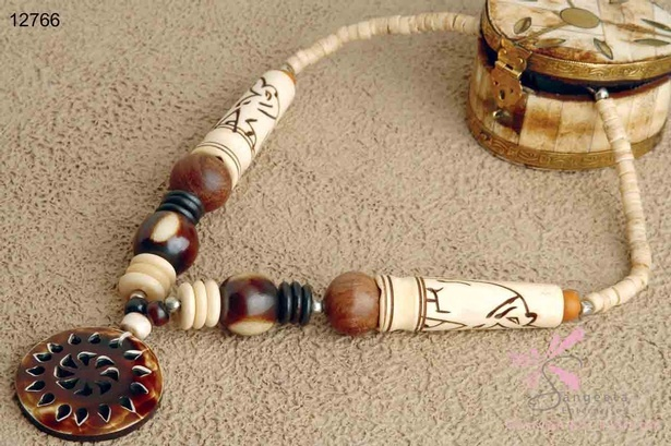 Fancy bone and wood necklace with a pendant