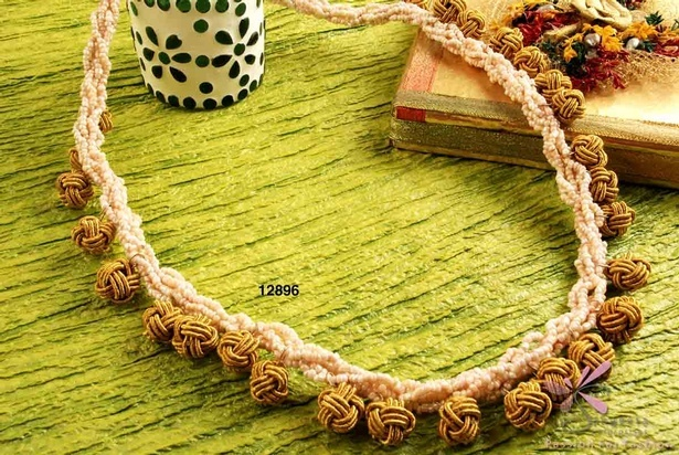 Glass and cloth beads necklace in beige and gold colour
