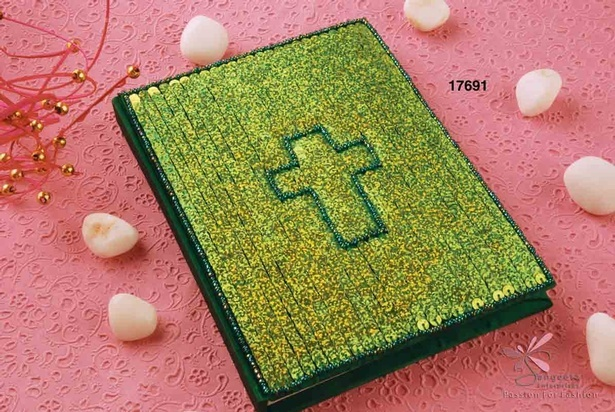 Handmade paper notebook with green sequins and a cross
