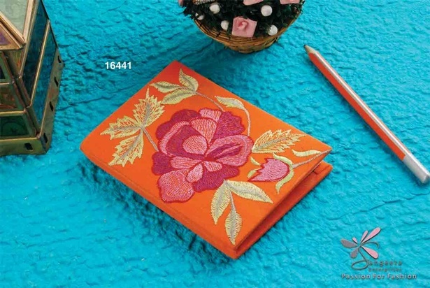 Beautifully rose embroidered notebook in orange colour