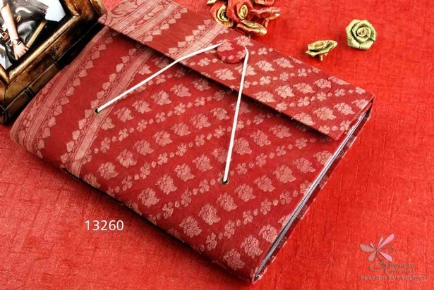 Fabric, photo album in red and off-white colour