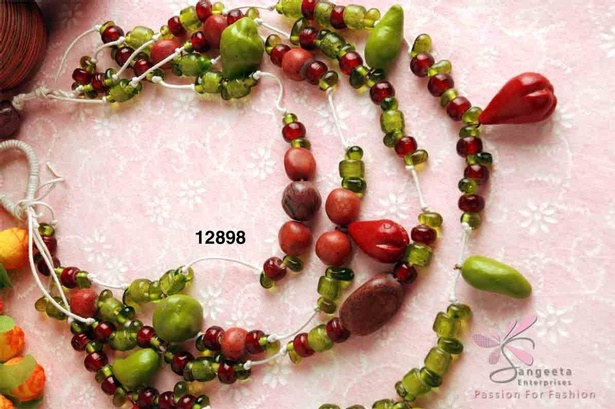 Multi strand necklace with fruit shaped beads