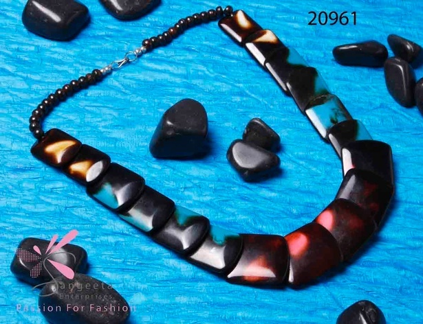 Resin and bone necklace in black colour with shades of orange, blue and red